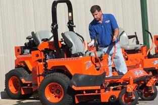 owner-robert-foster-ofbad-boy-mowers-inspects-a-mower-for-the-open-house
