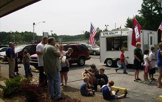 Folks enjoy Pepsi and Petit Jean Hot Dogs