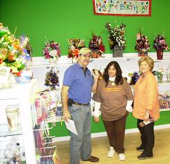 Bob Connel(Owner of KFFB 106.1 fm) Paulette Henson (Owner of Candy Bouquet of Clinton)l and Margaret McClain McEntire(Founder of Candy Bouguet)
