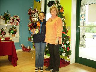 Mrs Margaret McClain McEntire takes time out for a picture in front of the Christmas Tree