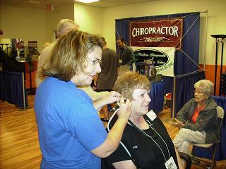 Triplet Hearing doing a Video Otoscopy test