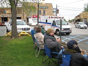 Folks start setting up to watch the parade