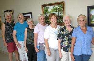 Artists hung a new exhibit at Ozark Health Medical Center Monday. Exhibit committee included (from left): Joyce Hartmann; Jan Cobb, Kathryn Jones, Freda May, Judy Shumann, Diana Foote, and Mary Shelton.