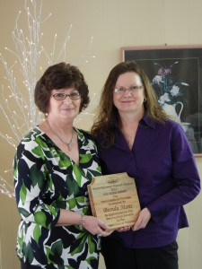 Tom Biggs Recipient Brenda Mans presented the top region award from Cathy Drew, Executive Director (Brenda Tourism Award)