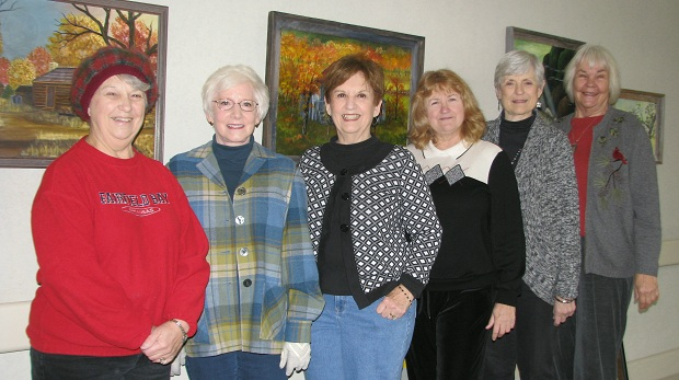 Hanging the new exhibit at the hospital on Monday, Jan. 13th, are (from left) NCAAL members Pauline Sears, Diana Foote, Judy Shumann, Alecs Long, Carolyn Goettsch, and Joyce Hartmann.