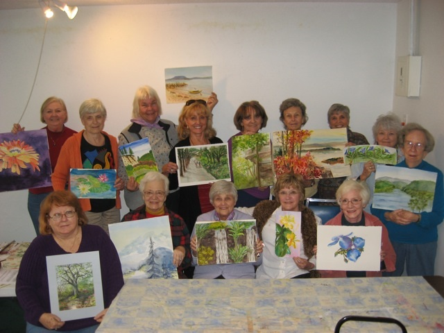 Participants Display One Of Their Paintings Completed During The Workshop: (Front row, from left): Connie Hood, President NCAAL, Ruby Krimm, Dorothy Hendrickson, Joan Bland, Diana Foote (back) Jan Cobb, Carolyn Goettsch, Joyce Hartmann, Charlotte Rierson, Kathleen Hadley, Jeanne Homuth, Instructor Sheila Parsons, Bettye Cooper, and Lea Berry.  Not pictured, Alecs Long, photographer.